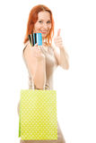 Woman with credit cards and shopping. Royalty Free Stock Photos