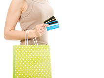 Woman with credit cards and shopping. Woman with many different credit cards and shopping isolated on white Royalty Free Stock Photo
