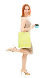 Woman with credit cards and shopping. Red hair woman with many different credit cards and shopping isolated on white Stock Images