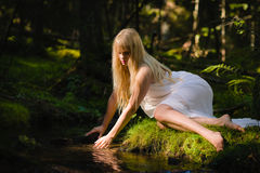 Woman on creek Royalty Free Stock Photo