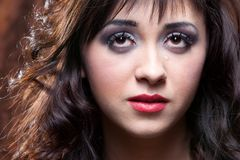 Woman cries. Young woman portrait with a tear in Edith Piaf style Royalty Free Stock Photography