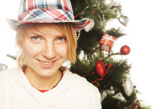 Woman and cristmas tree Royalty Free Stock Photo