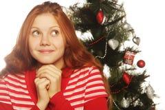 Woman and cristmas tree Stock Photos