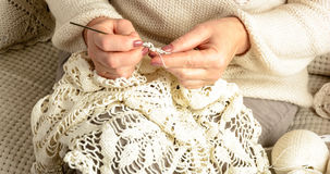Woman crochet tablecloth Royalty Free Stock Images