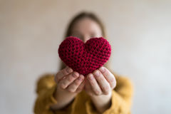 Woman with a crocheted heart Stock Photos