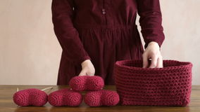 Woman and crocheted hearts stock video footage