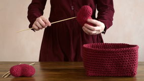 Woman with crocheted hearts stock video footage