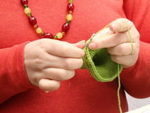 Woman crocheting with green yarn Stock Photos