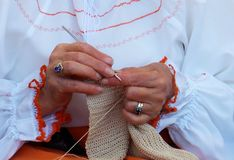 Woman crocheting by hand stock images