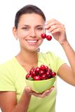 Woman with crockery of cherries in her hands. Stock Photos