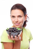 Woman with crockery of currants in her hands. Stock Photo