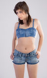 Woman in Crop Top and Jean Shorts Stock Photos
