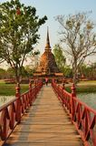 Woman cross bridge to pagoda Royalty Free Stock Photography