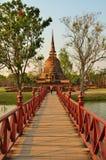 Woman cross bridge to pagoda Royalty Free Stock Photography