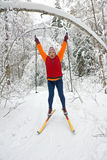 Woman cross country skier in forest Stock Photo