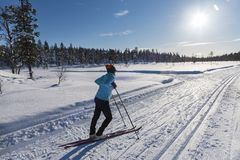 Woman cross country skiing in Lapland Finland Stock Photos