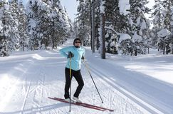 Woman cross country skiing in Lapland Finland Royalty Free Stock Image