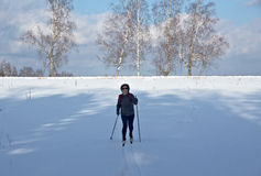 Woman  cross-country  skiing in sunny day Royalty Free Stock Images