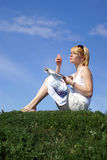 Woman cross-stitching in the park Royalty Free Stock Photo