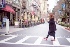 Woman cross street Royalty Free Stock Photography