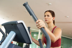 Woman On Cross Trainer Machine Royalty Free Stock Image