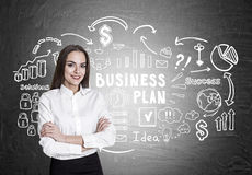 Woman with crossed arms, business plan Stock Photo