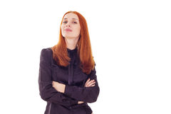 Woman with crossed arms and head held high Royalty Free Stock Photography