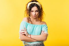 Woman crossed arms skepticism suspicious wary look. Pretty young woman looking at camera. Crossed arms pursed lips. Skepticism doubt facial expression royalty free stock photo