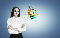 Woman with crossed arms and small bulb Stock Photos