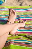 Woman crossed feet resting Stock Images