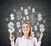 Woman with crossed fingers and dollar signs Stock Image