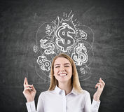 Woman with crossed fingers and shiny dollar signs Stock Image