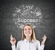 Woman with crossed fingers and success Stock Photo