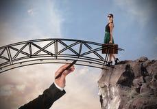Woman crosses a bridge Stock Images