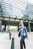 Woman crosses street near European Parliament building in Brussels, Belgium royalty free stock photography