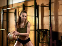 Woman with crossfit ball Royalty Free Stock Photo