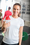 Woman at crossfit center taking a break Stock Image