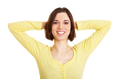 Woman crossing arms behind her head Royalty Free Stock Photography