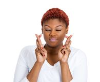 Woman crossing fingers Stock Photography