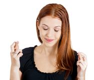 Woman crossing fingers Stock Images
