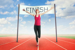 Woman crossing the finish line. Woman racing, crossing the finish line Royalty Free Stock Photo
