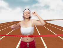 Woman crossing Finishing Line. Portrait of woman holding scroll crossing finishing line Royalty Free Stock Images