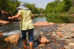 Woman Crossing River Royalty Free Stock Images
