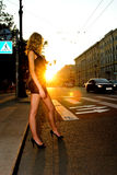 Woman crossing road Royalty Free Stock Image
