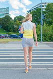 Woman crossing the road. Stock Images