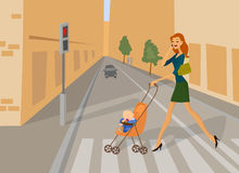 Woman crossing road on the red traffic light. Young woman speaking on the phone and crossing road on the red traffic light for pedestrians with her baby sleeping Stock Photography