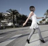 Woman crossing the street Stock Photo