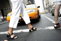 Woman crossing street stock photography