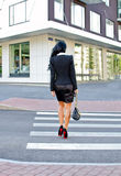 Woman crossing the street. Back view Royalty Free Stock Photo