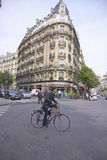 Woman crossing street on bicycle, Paris, France Royalty Free Stock Photos
